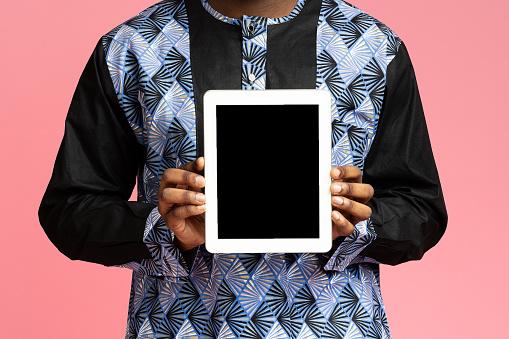 Digital tablet with empty screen in black man hands