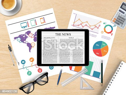 525811918 istock photo Digital tablet with financial graph 604902126