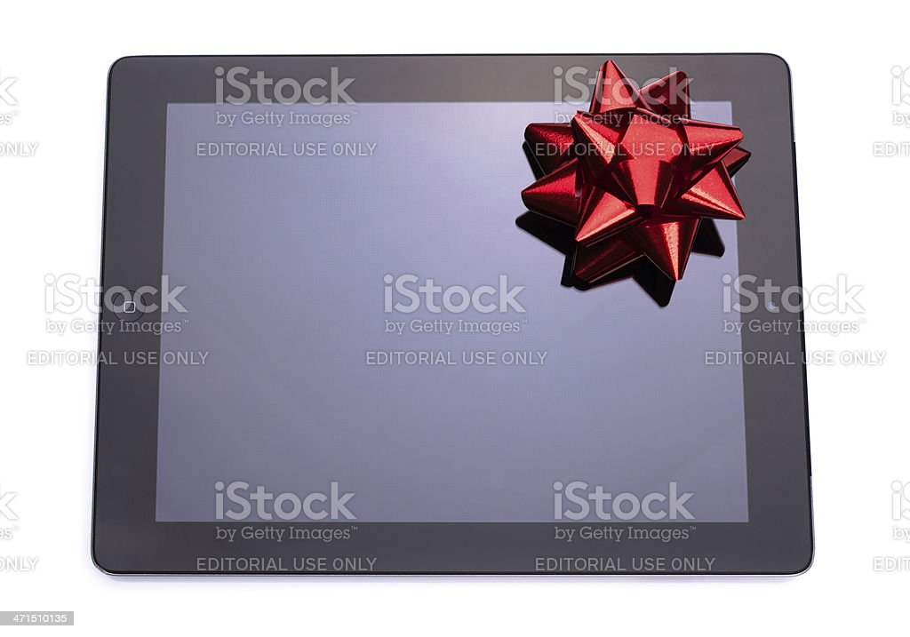 digital tablet with red ribbon royalty-free stock photo