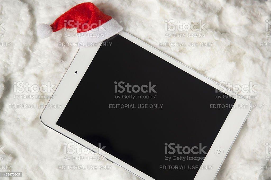 Digital tablet with santa hat stock photo