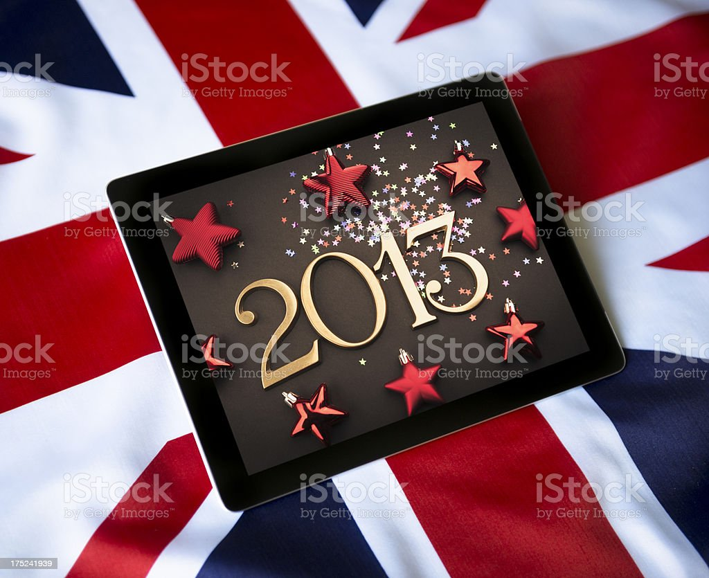 Digital tablet with the 2013 picture against UK flag royalty-free stock photo