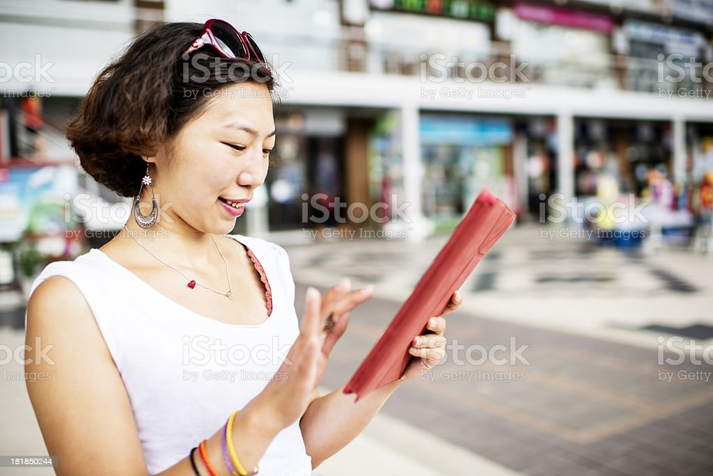 Digital Tablet Woman At the Mall royalty-free stock photo