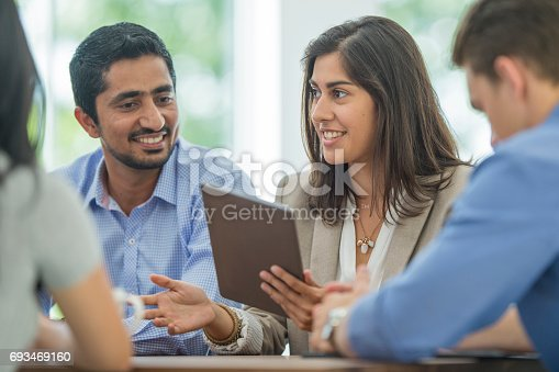 862718922 istock photo Digital Technology in a Business Meeting 693469160