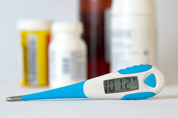 Digital Thermometer and Medication stock photo