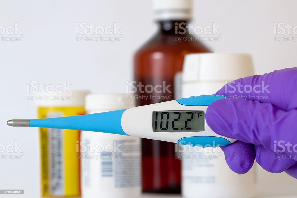 Digital Thermometer and Medications royalty-free stock photo