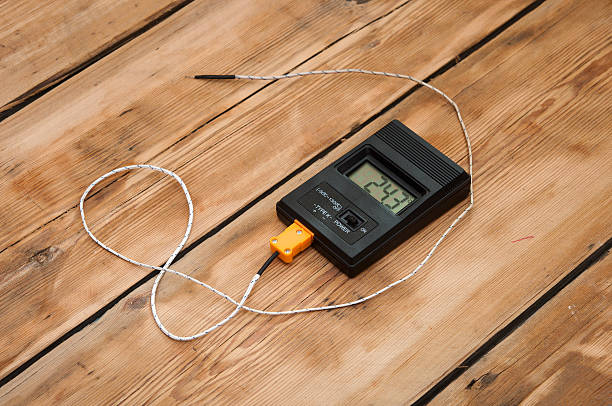 Digital thermometer on wooden table top stock photo