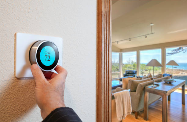 Digital Thermostat: Home thermostat for internet wireless technology Smart Home: Digital thermostat heating and cooling automation system ++interface designed by photographer+++ smart thermostat stock pictures, royalty-free photos & images