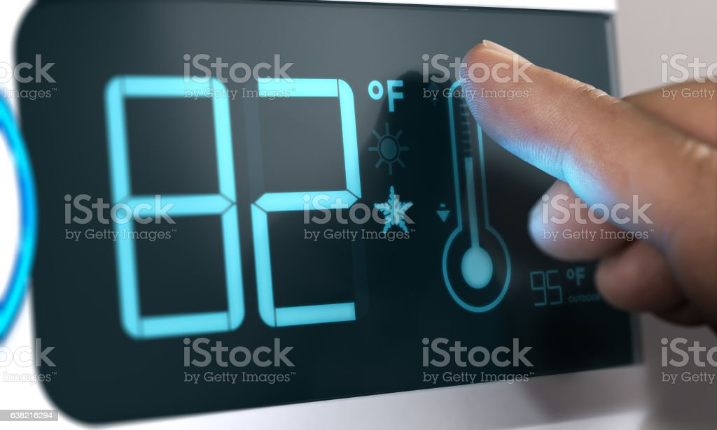 Digital Thermostat Temperature Controller Set at 82 Degrees Fahr stock photo