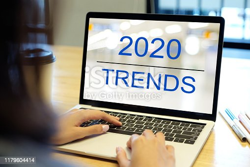 istock 2020 digital trends, Woman hand tying laptop computer with 2020 trends on screen background, digital marketing, business and technology concept 1179604414