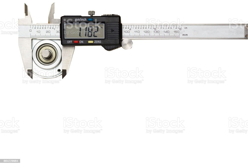 Digital vernier caliper measuring the outer diameter of the encoder unit placed on the white background, Red plastic clamp lay near by. 7-segment display the accuracy of measurement value royalty-free stock photo