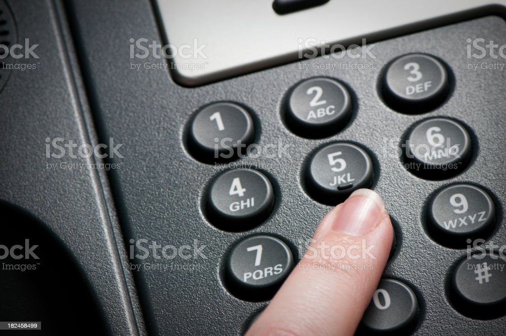 Digital VoIP conference phone, keypad close-up, finger dialing stock photo