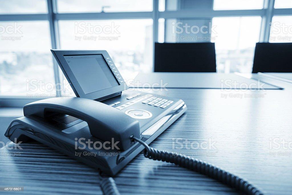 Modern digital VoIP phone in modern office environment