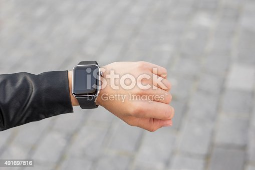 Digital wristwatch on womans hand