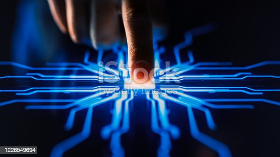 Digitalization Concept: Human Finger Pushes Touch Screen Button and Activates Futuristic Artificial Intelligence. Visualization of Machine Learning, AI, Computer Technology Merge with Humanity