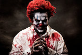 Digitally altered image of evil, bloody clown