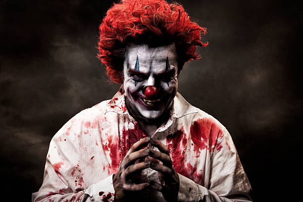 digitally altered image of evil, bloody clown - killer stock photos and pictures