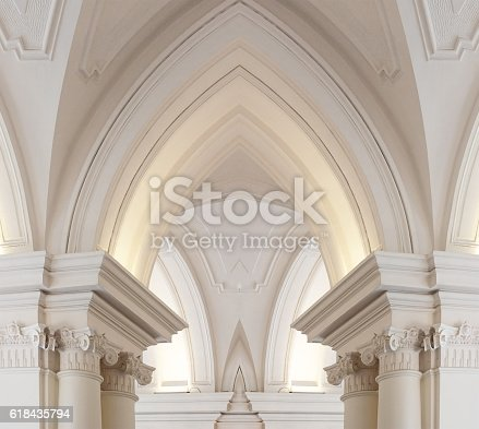 Baroque goes Gothic. Digitally composed photo of Baroque architecture fragment has formed a Gothic arch. Realistic (though fictional) architectural object.