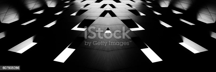 Digitally composed wide angle photo of modular concrete wall with unusual windows in backlight. Contemporary architecture fragment in hi-tech / minimalism style. Realistic but unreal architectural image in black and white.