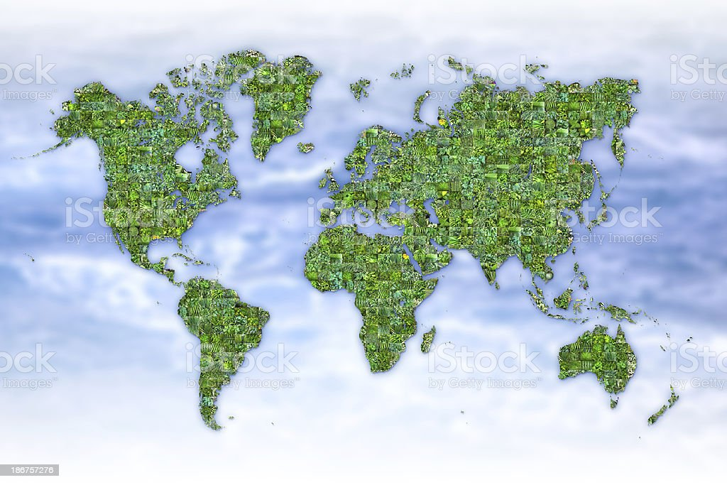 Digitally generated mosaic of world map with green photos stock photo