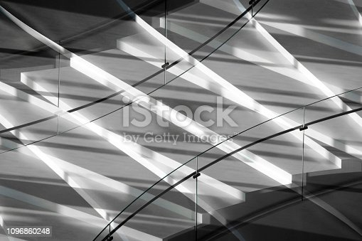 istock Digitally rendered image of stairs with glass balustrade in contrast shadows. Modern architecture abstract. 1096860248