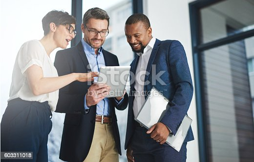 603310486istockphoto Digitizing business discussions 603311018