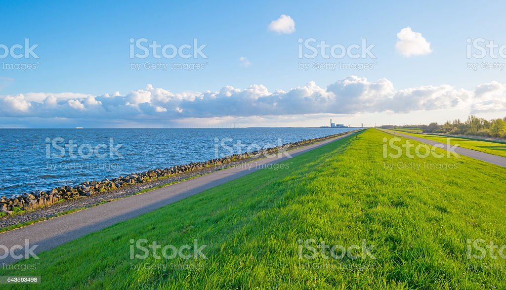 Dike along a lake in spring stock photo