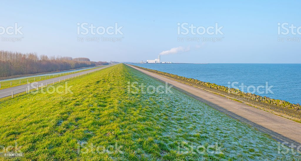Dike along a lake in winter stock photo