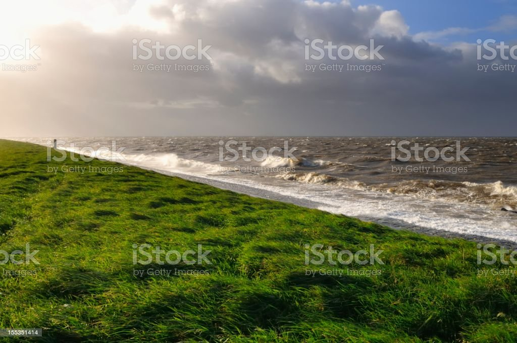 Dike in a storm stock photo