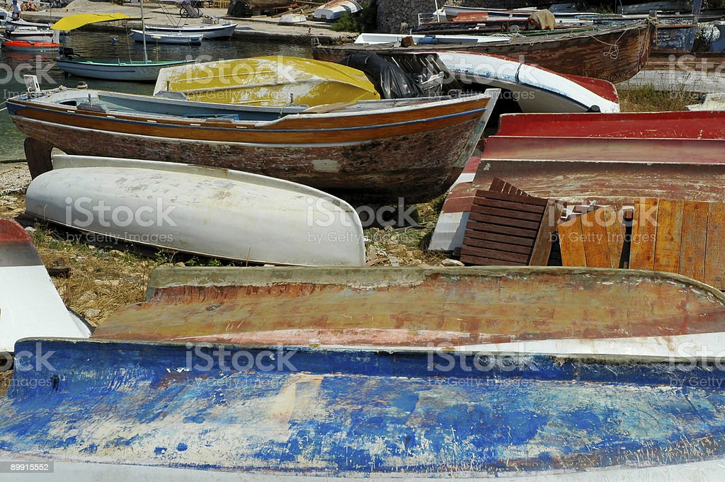 Dilapidated boats in an Adriatic port royalty-free stock photo