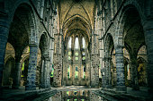 istock Dilapidated church in abandoned Villers Abbey 592031298