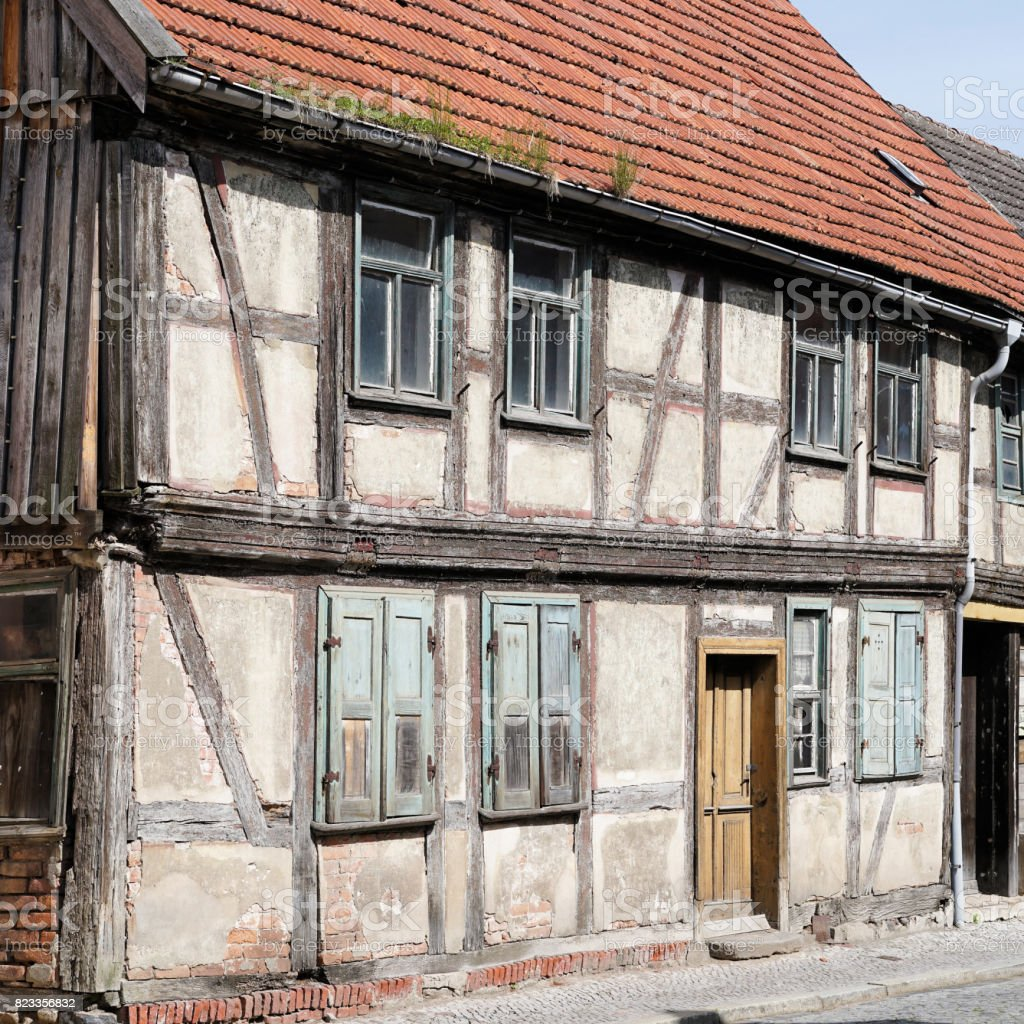 dilapidated half-timbered house stock photo