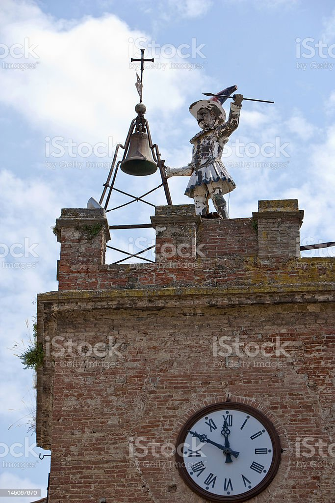 Dilapidated statue on clock tower stock photo