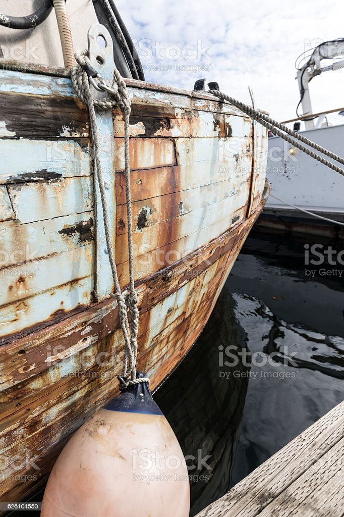 Dilapidated Wooden Commercial Fishing Boat stock photo