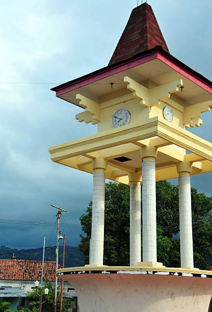 dili, east timor: clock tower - lulik stock photos and pictures