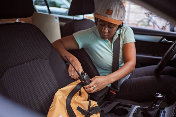 Diligent car delivery woman Black ethnicity preparing everything so she can start to deliver stock photo