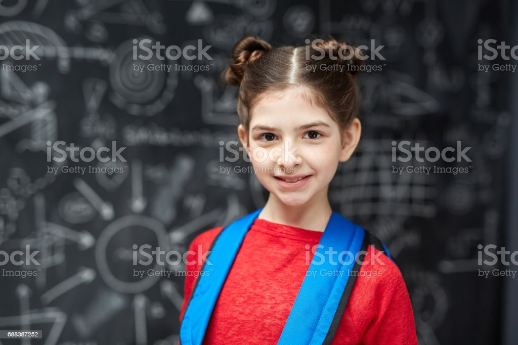Diligent Little Student Posing at Blackboard Lizenzfreies stock-foto