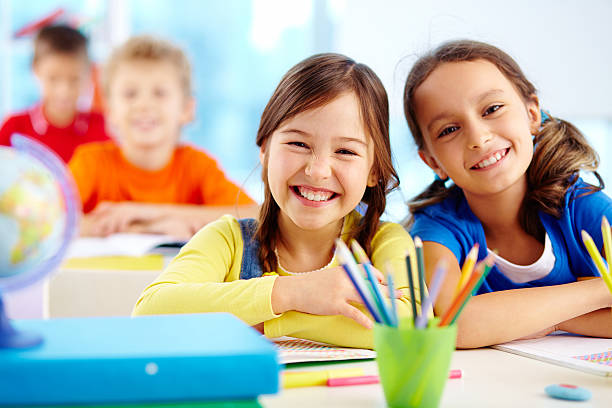 diligent pupils - primary school stock pictures, royalty-free photos & images