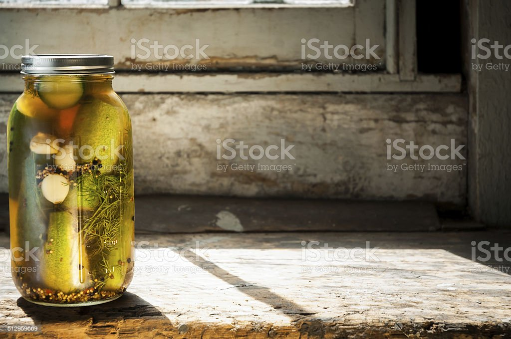 Dill pickles with sunlight stock photo