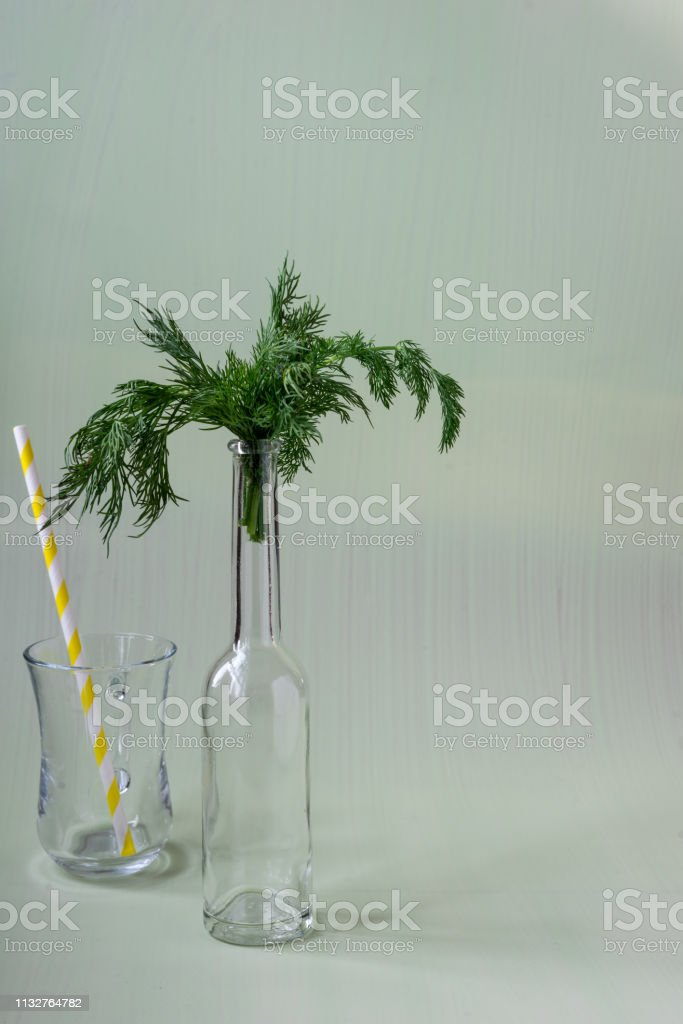 Dill with yellow and white straw, fresh food and drink photography,...