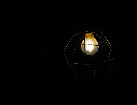 Dim Light Bulb On Dark Background Stock Photo Download Image Now Istock