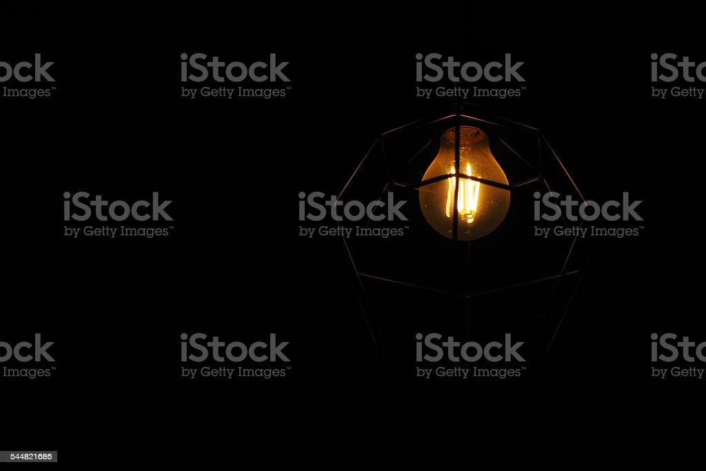 Dim Light Bulb On Dark Background Stock Photo