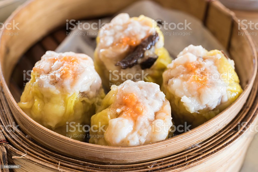 dim sum in bamboo steam containers stock photo