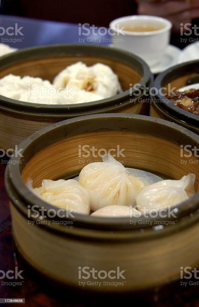 Dim sum: shrimp dumplings and pork buns royalty-free stock photo