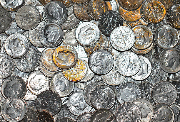 I dime at a time Dimes in a pile dime stock pictures, royalty-free photos & images