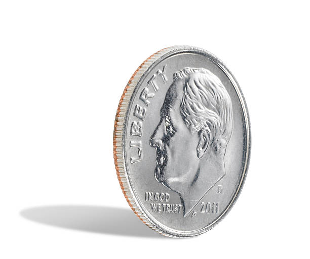 US dime on white background A US dime, ten cents, isolated on a white background with a shadow. There is a clipping path which may be used to delete the shadow if desired. dime stock pictures, royalty-free photos & images