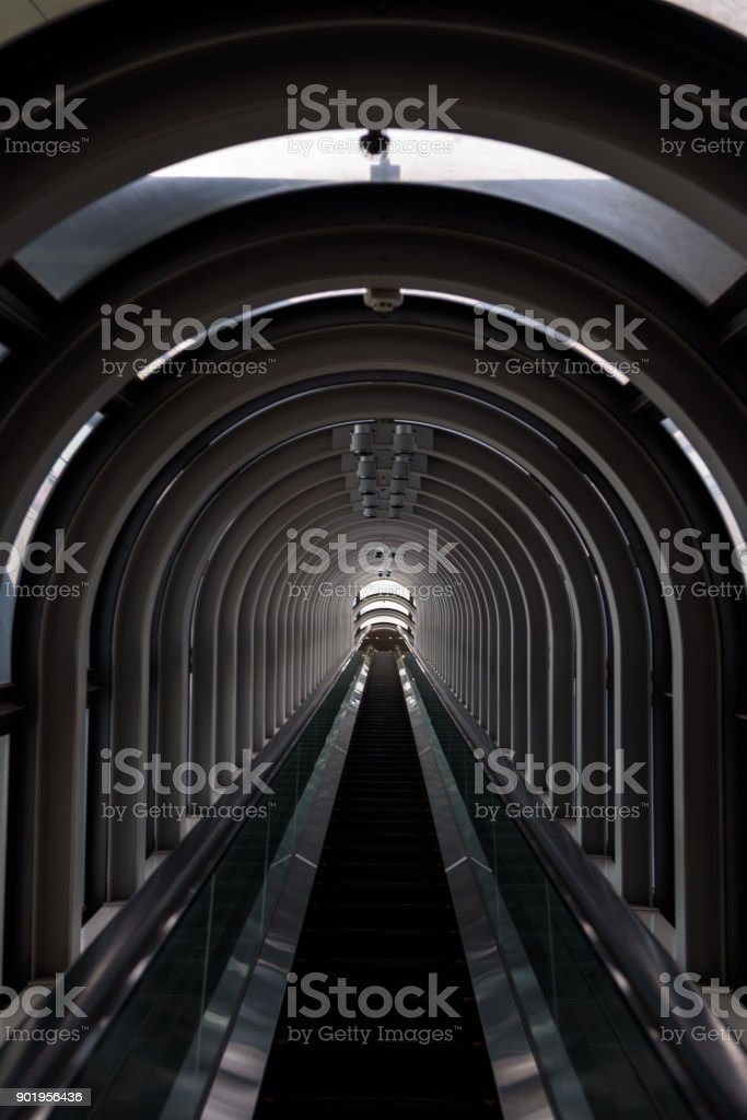 Diminishing perspective in a futuristic escalator tube stock photo