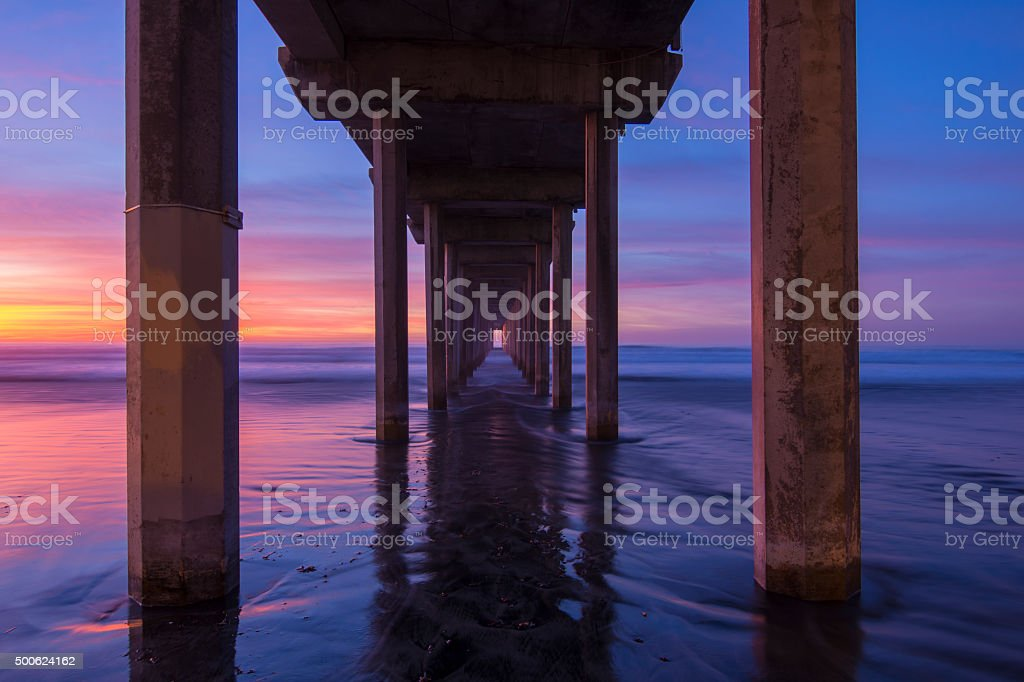Diminishing perspective under concrete pier stock photo