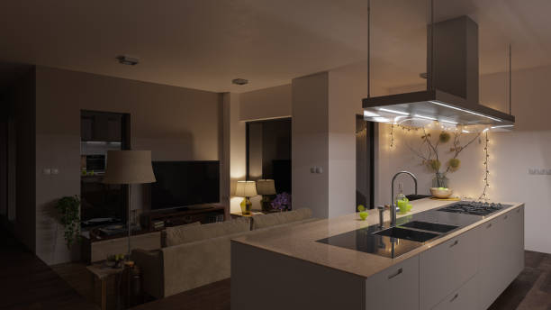 dimly illuminated open plan kitchen and living room at night - dimly stock pictures, royalty-free photos & images
