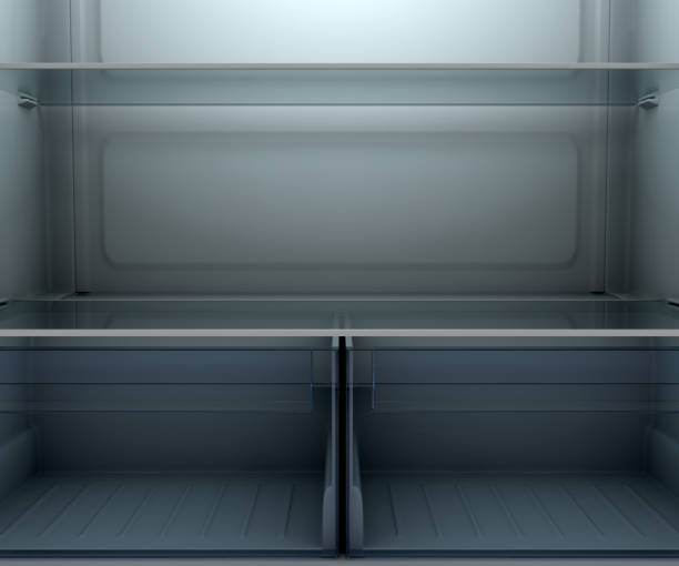 dimly lit empty fridge interior - dimly stock pictures, royalty-free photos & images