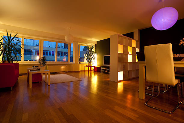 dimly lit living room with wood floors - dimly stock pictures, royalty-free photos & images